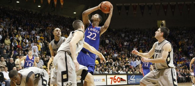 Kansas forward Marcus Morris battles inside for a bucket amidst the Colorado defense during overtime Wednesday, Feb. 3, 2010 at the Coors Event Center in Boulder.