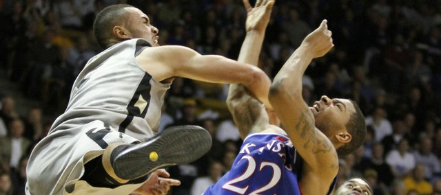 Colorado forward Marcus Relphorde fouls Kansas forward Marcus Morris during the second half Wednesday, Feb. 3, 2010 at the Coors Event Center in Boulder.