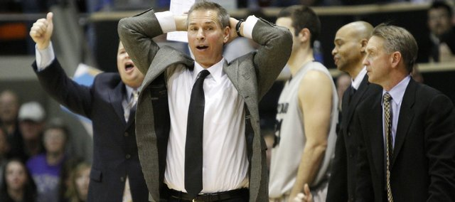Wanting a foul called, Colorado head coach Jeff Bzdelik holds his hands on his head during overtime.