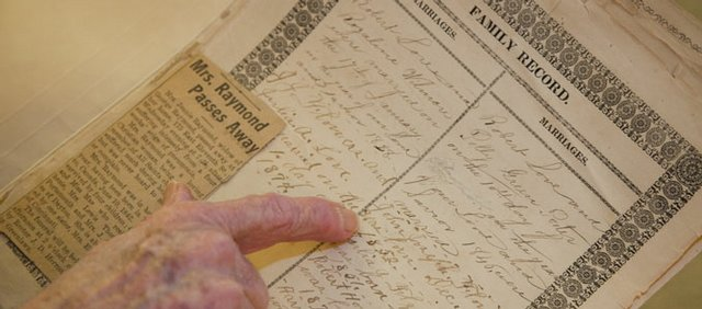 Winifred Lynch looks at the lineage documented in her family Bible. It belonged to her mother's adoptive family. Lynch hopes that she can find long-lost family members to take the Bible because she believes it should be in the possession of someone with blood ties to the people who originated the book.