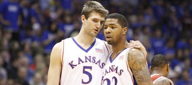Kansas center Jeff Withey (left) and forward Marcus Morris speak after a timeout in the first half, Saturday, Feb. 6, 2010 at Allen Fieldhouse.