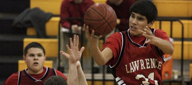 Lawrence high sophomore Anthony Buffalomeat (31) attempts a layup in the second half. Buffalomeat scored 10 points, but the Lions lost, 50-38, to Shawnee Mission West on Friday in Overland Park.