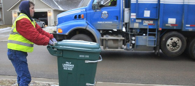 Journal-World reporter Chad Lawhorn got first-hand experience Tuesday helping city sanitation workers do their routes in Lawrence.