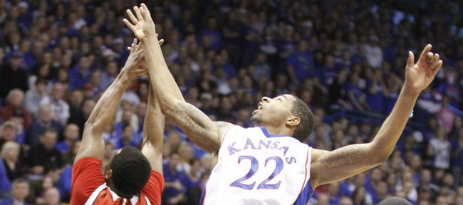 Kansas forward Marcus Morris goes for a rebound over Nebraska defenders Brandon Richardson, Christian Standhardinger and Lance Jeter in the first half, Saturday, Feb. 6, 2010 at Allen Fieldhouse.
