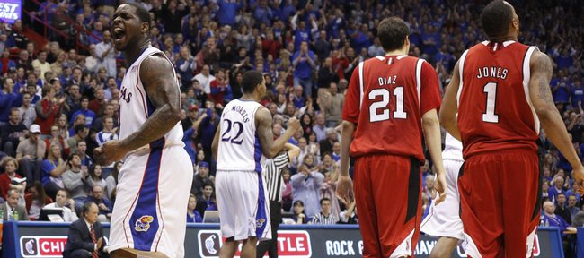 Kansas guard Sherron Collins roars to the student section after the Jayhawks force a turnover against Nebraska in the second half, Saturday, Feb. 6, 2010 at Allen Fieldhouse.