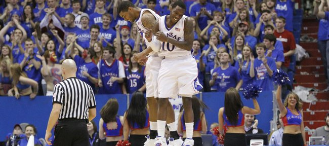 Kansas teammates Marcus Morris and Tyshawn Taylor (10) celebrate a Morris bucket in the second half, Saturday, Feb. 6, 2010 at Allen Fieldhouse.