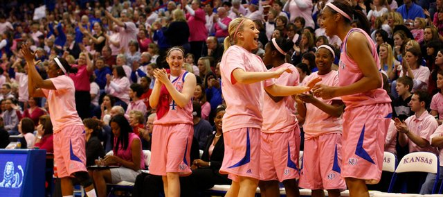 """Kansas University's Kelly Kohn, foreground left, and Carolyn Davis celebrate with the rest of the bench in this Feb. 7, 2010, file photo. The KU women will participate in their """"Think Pink"""" game on Saturday against Missouri."""