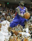 Kansas guard Sherron Collins looks for an outlet as he leaps past Texas guard Avery Bradley during the second half, Monday, Feb. 8, 2010 at the Frank Erwin Center in Austin.
