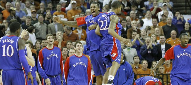 Kansas forward Thomas Robinson and Marcus Morris give each other a flying chest bump during a Jayhawk run against Texas in the first half, Monday, Feb. 8, 2010 at the Frank Erwin Center in Austin.