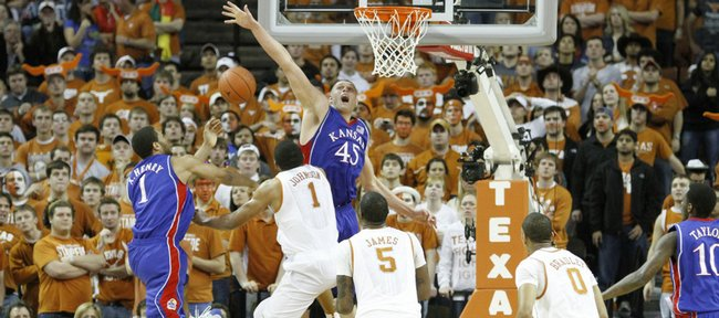 Kansas center Cole Aldrich blocks Texas forward Gary Johnson's shot during the second half, Monday, Feb. 8, 2010 at the Frank Erwin Center in Austin.