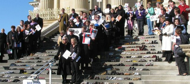 Advocates of a statewide ban on indoor smoking in public places gather in February 2010 on the east steps of the Capitol. They placed 380 pairs of shoes to represent those Kansans who die annually from second-hand smoke.