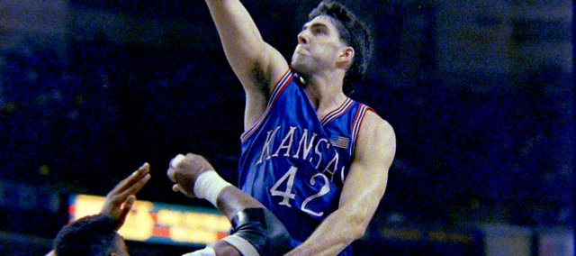 Kansas University's Mark Randall goes up for a basket against Arkansas. Third-seeded KU upset Arkansas on March 23, 1991.