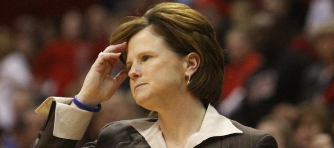 Kansas coach Bonnie Henrickson shows frustration after the Jayhawks gave up the lead to Nebraska in the final minutes, losing 67-60.