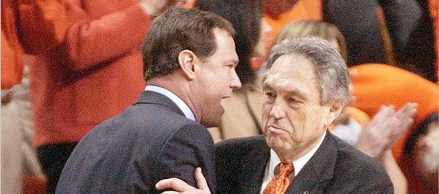 "Kansas coach Bill Self, left, congratulates Oklahoma State's Eddie Sutton after the Jayhawks' 80-60 loss to OSU in their last trip to Stillwater, Okla. Self made his first trip to his alma mater as coach of the Jayhawks for that ""embarrassing"" setback on Feb. 9, 2004. His second trip back is today."
