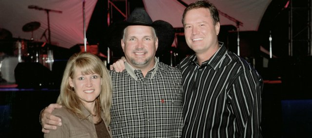 KU coach Bill Self, right, and wife Cindy Self, left, went to college at Oklahoma State with country music icon Garth Brooks, center.