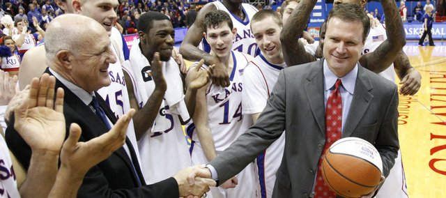 Kansas head coach Bill Self accepts a basketball presented by athletic director Lew Perkins in commemoration of his 400th career win, which came with a 73-59 win over Iowa State Saturday, Feb. 13, 2010 at Allen Fieldhouse.