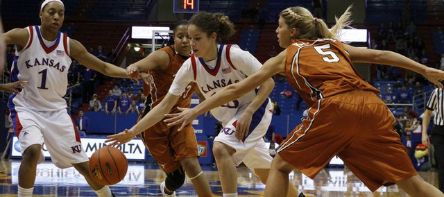 KU freshman Monica Engelman (13) weaves through the Texas defense in overtime Saturday, Feb. 13, 2010 at Allen Fieldhouse.