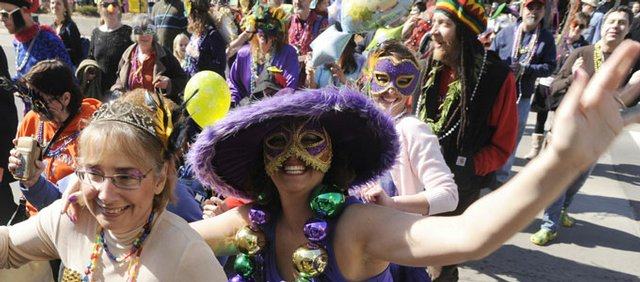 Manhattan residents Jennifer Stalder and her mother Patty Stalder were just two of the colorfully dressed fans of Fat Tuesday in downtown Lawrence Feb. 24, 2009, for a parade that grew to about 150 Mardi Gras revelers.