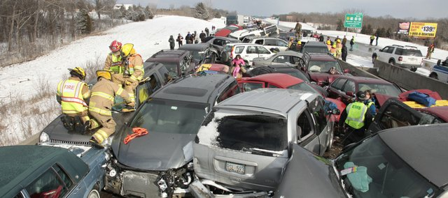 Paramedics and firefighters worked for hours to free motorists trapped in their cars after sudden winter weather caused vehicles to pile on top of each other on Interstate 70 between Lawrence and Bonner Springs Feb. 14, 2010.
