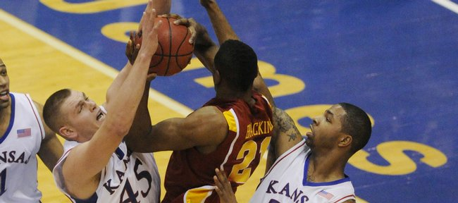 Kansas center Cole Aldrich (45) and Marcus Morris (22) pressure Iowa State's Craig Brackins (21) Saturday, Feb. 13, 2010 at Allen Fieldhouse.