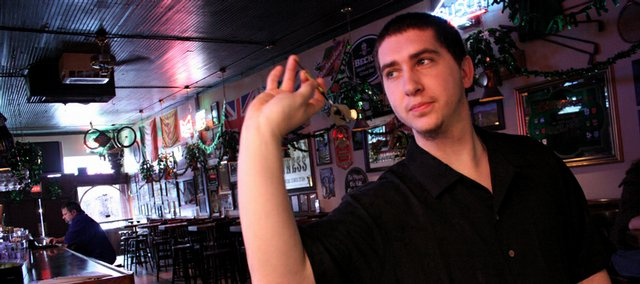 Mike Walters, of Lawrence, practices darts at the Red Lyon, 944 Mass. Walters is the president of the Lawrence Dart Association.
