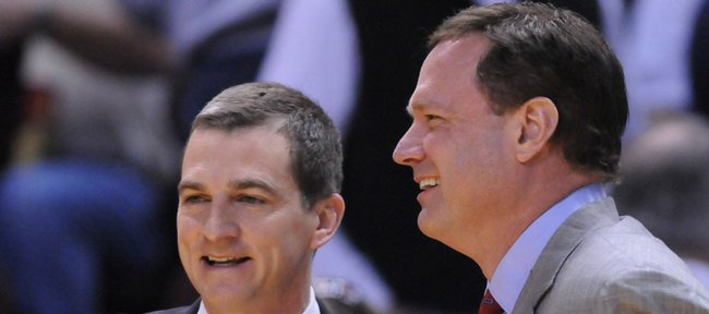 Kansas head coach Bill Self greets Texas A&M head coach Mark Turgeon, a former Jayhawk guard prior to the start of the game Saturday, March 8, 2008 at Reed Arena in College Station.