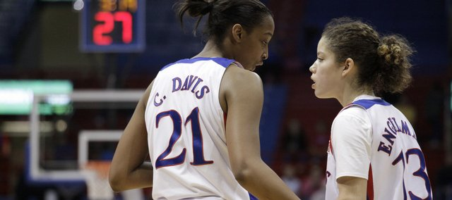 KU freshmen Carolyn Davis (21) and Monica Engelman (13) discuss strategy against Texas Saturday, Feb. 13, 2010 at Allen Fieldhouse.