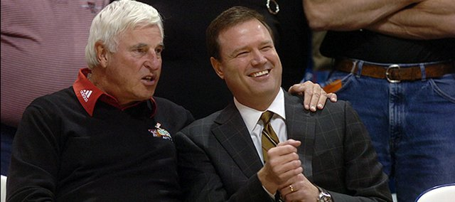 Texas Tech's coach Bob Knight, left, talks with KU's coach Bill Self before a Jan. 2006 game between Kansas and Texas Tech.