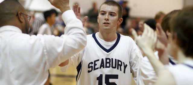 Seabury academy senior Bill Gibbs (15) gets a high-five from coach Mike Harding. The Seahawks beat Cair Paravel, 70-52, on Thursday at Seabury.
