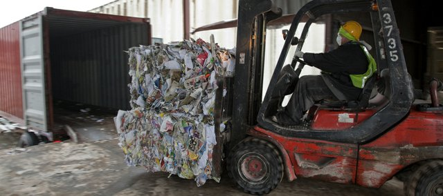 Giant bales of paper at the Deffenbaugh Industries facility in Kansas City, Kan., are loaded on trailer containers that will eventually be transported to China. Deffenbaugh has announced that they will offer weekly curbside recycling for Lawrence residents. Just a couple of weeks after the city commission said it was going to leave curbside recycling to private haulers, the largest recycling company in the region is jumping into the Lawrence market.