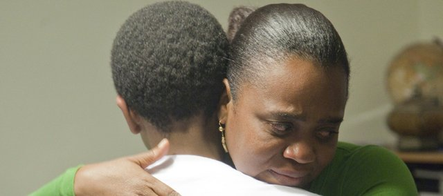 Rachelle Esperance, 38, Lawrence, hugs her son Sebastian, 12, on Friday. Rachelle and Sebastian's younger brother Olivier, 2, were buried in the debris of Rachelle's brother's house in Port-au-Prince, Haiti, during the Jan. 12 earthquake. Sebastian had remained in Lawrence with relatives and was reunited with his mother and brother on Feb. 11.