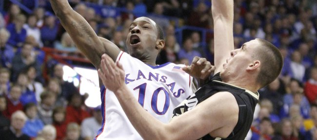 Colorado forward Shane Harris-Tunks fouls Kansas guard Tyshawn Taylor as he soars to the bucket during the second half, Saturday, Feb. 20, 2010 at Allen Fieldhouse.