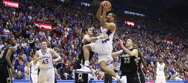 Kansas forward Xavier Henry is fouled by Colorado forward Casey Crawford on his way to the bucket during the second half, Saturday, Feb. 20, 2010 at Allen Fieldhouse.