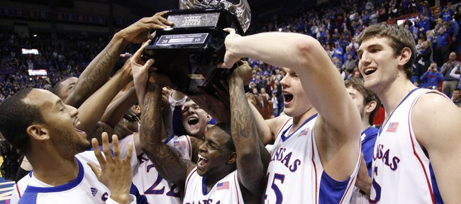 The Kansas Jayhawks dance with their sixth-consecutive Big 12 Conference title trophy after their 81-68 win over Oklahoma, Monday, Feb. 22, 2010 at Allen Fieldhouse. From left are Travis Releford, Sherron Collins, Cole Aldrich and Jeff Withey.
