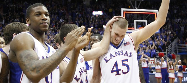 Kansas center Cole Aldrich waves to the Allen Fieldhouse crowd after he was announced the NCAA Basketball Academic All-American of the Year Monday, Feb. 22, 2010.