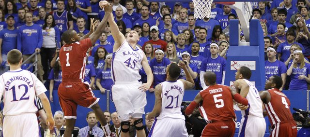 Kansas center Cole Aldrich blocks Oklahoma forward Ryan Wright's shot during the first half, Monday, Feb. 22, 2010 at Allen Fieldhouse.