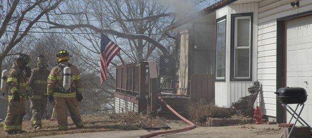Fire crews battle a house fire in Eudora Wednesday, Feb. 24, 2010.