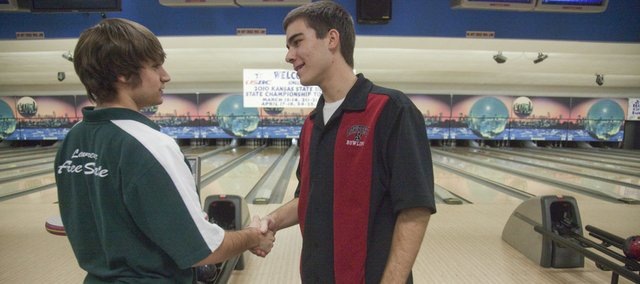 Free State senior Robert Wagner, left, shakes hands with Lawrence High senior Tanner Kilmer before they bowl. The Free State boys and girls bowling teams won Tuesday at Royal Crest Lanes.
