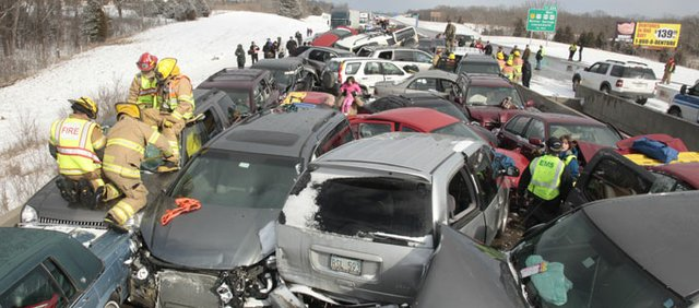 Journal-World photographer Richard Gwin photographed the scene of a pileup on Interstate 70 after a sudden snowstorm Feb. 14.