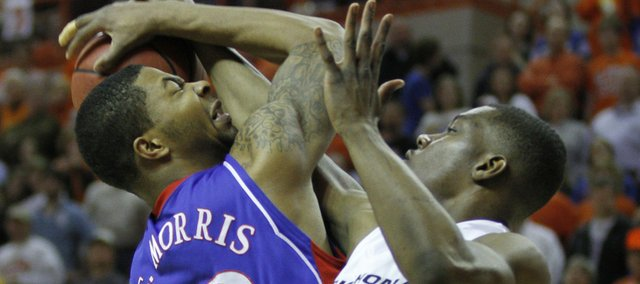 Kansas forward Marcus Morris collides with Oklahoma State guard Obi Muonelo during the first half, Saturday, Feb. 27, 2010 at Gallagher-Iba Arena in Stillwater.