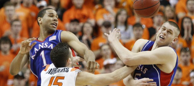 Kansas center Cole Aldrich, right, and forward Xavier Henry tangle with Oklahoma State guard Nick Sidorakis during the first half, Saturday, Feb. 27, 2010 at Gallagher-Iba Arena in Stillwater.