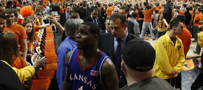 Kansas guard Sherron Collins leaves the floor with teammates as Oklahoma State fans rush the court following the Jayhawks' 85-77 loss, Saturday, Feb. 27, 2010 at Gallagher-Iba Arena in Stillwater.
