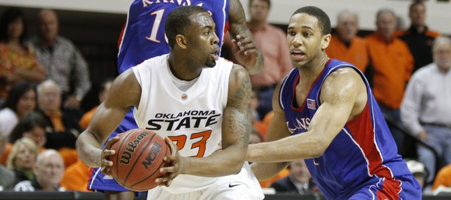 Kansas defenders Tyshawn Taylor, left, and Xavier Henry collapse on Oklahoma State forward James Anderson as he looks for an outlet late in the second half, Saturday, Feb. 27, 2010 at Gallagher-Iba Arena in Stillwater.
