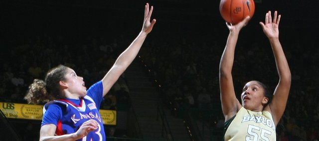 Baylor's Morghan Medlock, right, shoots over Kansas' Monica Engelman (13) and Aishah Sutherland. The Bears beat the Jayhawks, 70-47, Sunday in Waco, Texas.