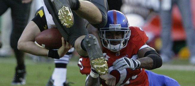 Kansas safety Darrell Stuckey upends Missouri quarterback Blaine Gabbert during the second quarter, Saturday, Nov. 28, 2009 at Arrowhead Stadium.