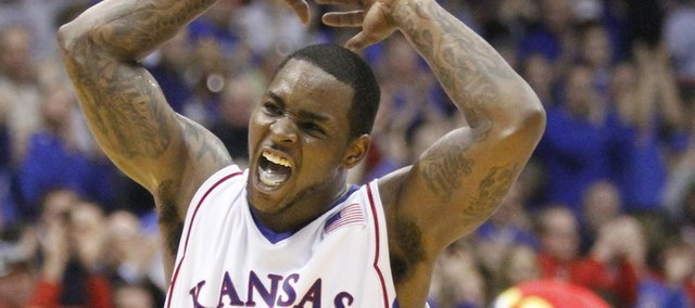 Kansas guard Sherron Collins gets the Fieldhouse crowd on its feet after a put-back dunk by center Cole Aldrich during the second half.