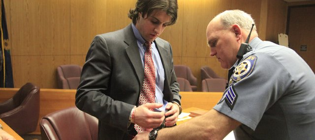 Matthew Jaeger, 24, is handcuffed by Douglas County Sheriff's Sgt. Ken Fangohr in Douglas County Court after being sentenced by Judge Robert Fairchild to 106 months for kidnapping, aggravated battery and criminal threat, stemming from an attack on his ex-girlfriend, Mary Francis Biggs in October 2007.