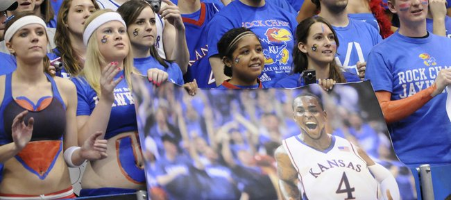 KU fans pull down posters of Sherron Collins at the end of KU's 82-65 win over the the Kansas State Wildcats Wednesday, March 3, 2010 at Allen Fieldhouse.