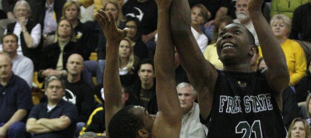 Junior Eric Watson (21) goes up for two in a game featuring Free State and Shawnee Mission West Thursday, Mar. 4, 2010 in boys sub-state in Overland Park. Free State won 29-27.