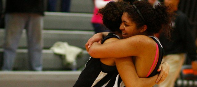 Free State&#39;s Chantay Caron and Amarra Lee hug on the court after the Firebirds defeated SM West on Friday, March 5, 2010, at Shawnee Mission Northwest High School.